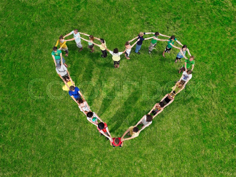 Group in heart shape formation, stock photo