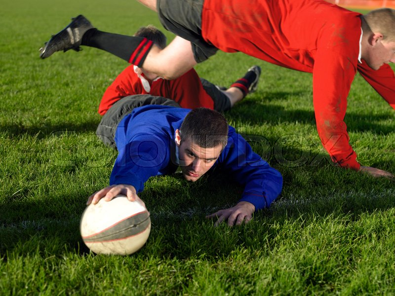 Rugby player scoring a try, stock photo