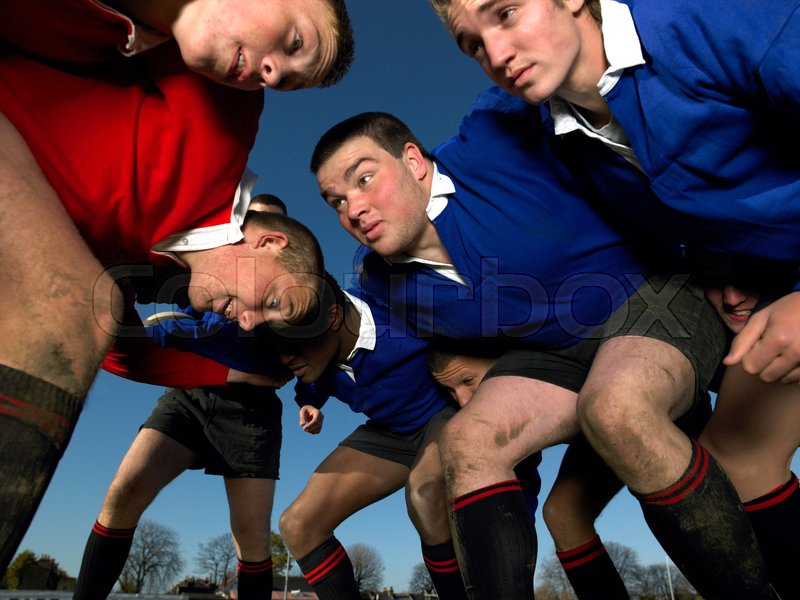 Rugby players in a scrum, stock photo