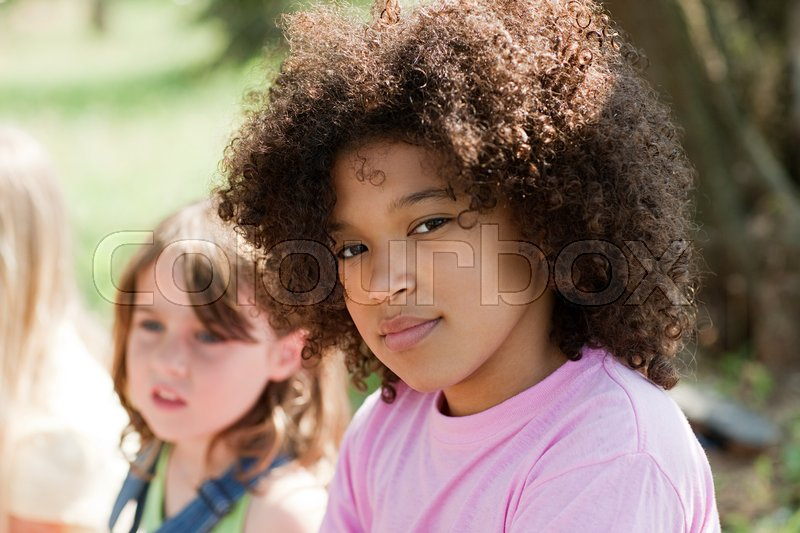 Pensive girl looking at camera, portrait, stock photo