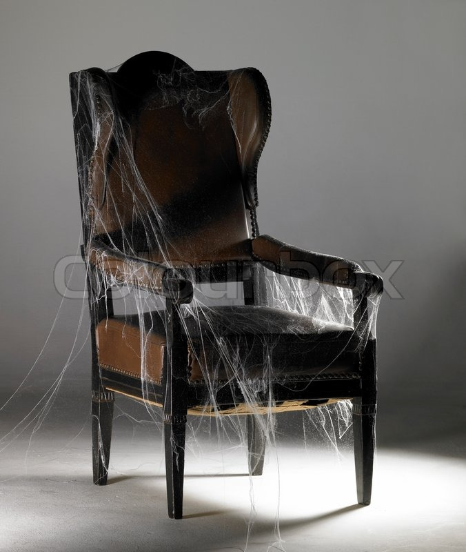 Brown wing chair and cobwebs stock photo colourbox for Ohrensessel wiki