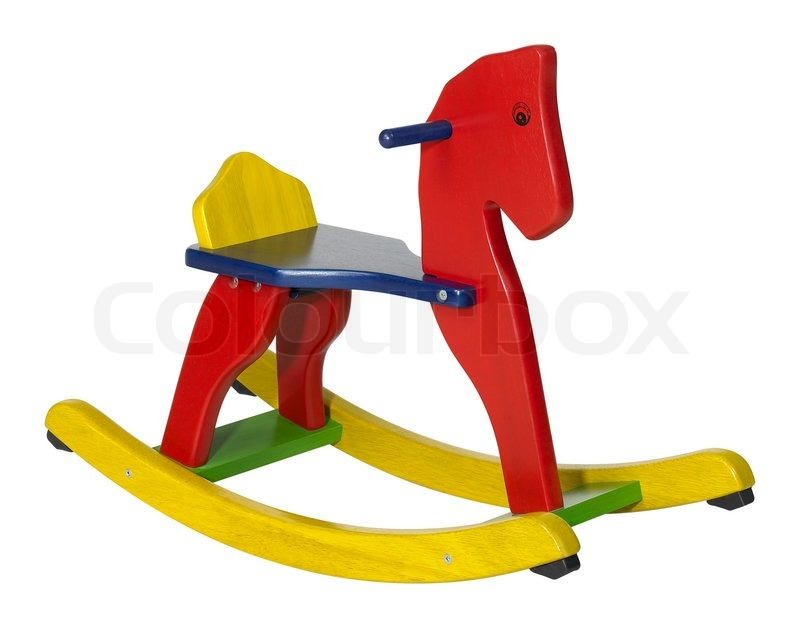 Studio photography of a colorful wooden rocking horse in ...
