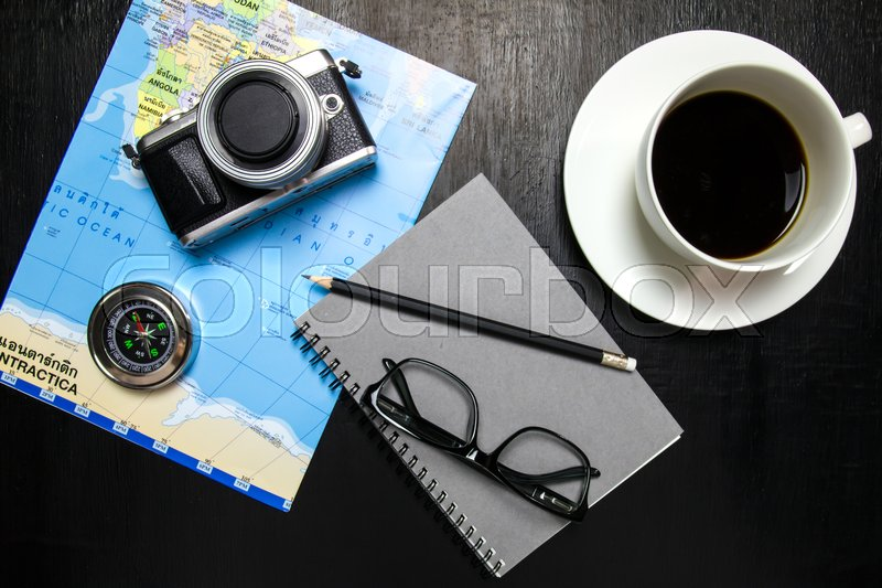 Top view of office desk workspace with coffee cup camera world map top view of office desk workspace with coffee cup camera world map compassnotebookpencil glasses on wooden background stock photo colourbox gumiabroncs Images
