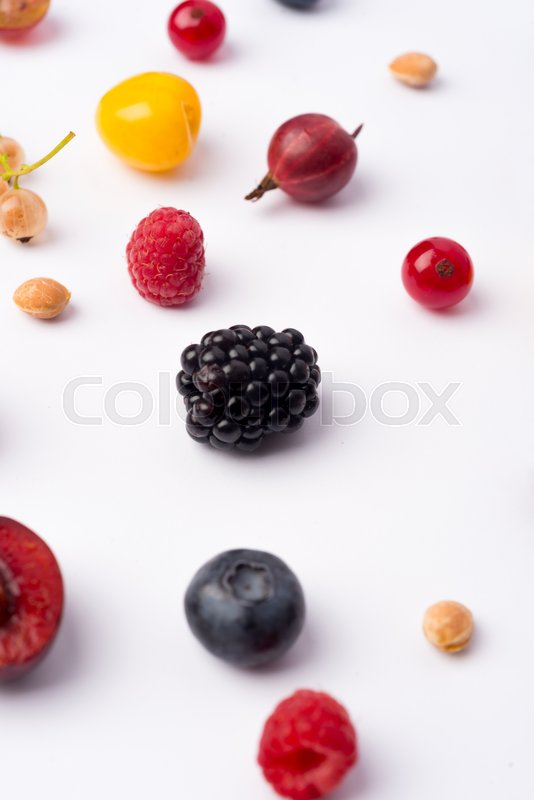 Stock image of 'Photo of mix of berries isolated over white background table.'