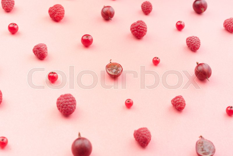Stock image of 'Top View Picture of mix of berries isolated over pink background table.'