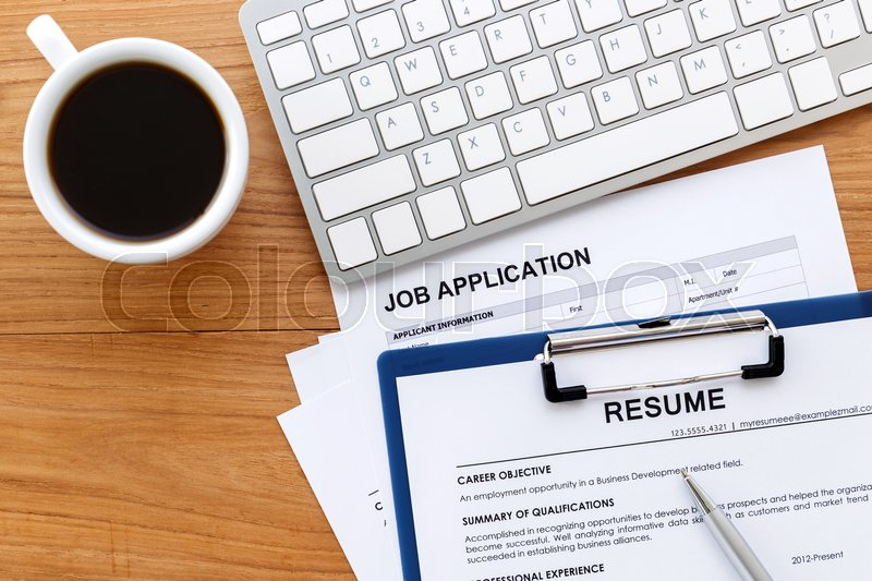 Stock image of 'Resume and job application on work desk background for job search concept'