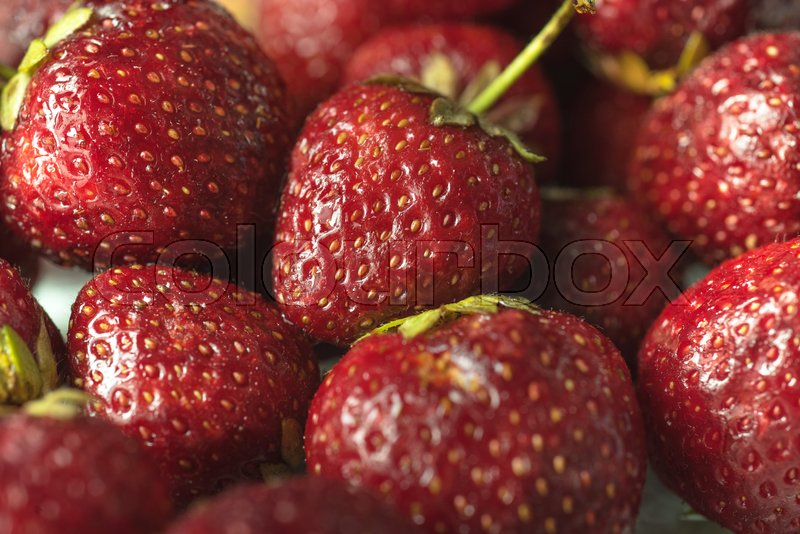 Stock image of 'Picture of fresh ripe perfect strawberry. Macro.'