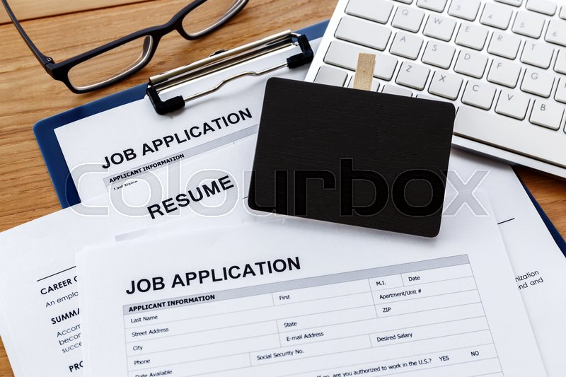 Stock image of 'Job hiring and applying concept with blank sign on work desk'