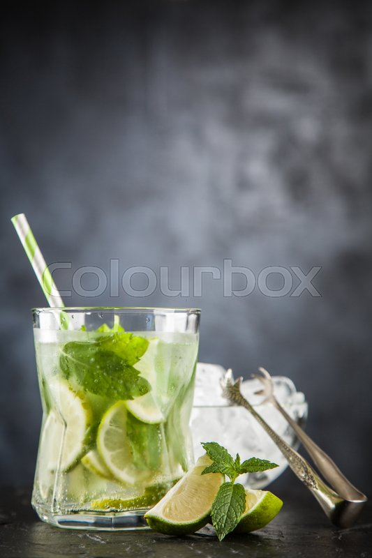 Stock image of 'Mojito cocktail on dark background.'
