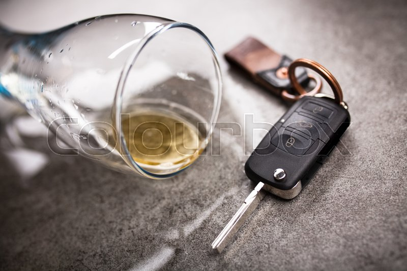 Stock image of 'Drunk driving concept - spilled beer and car keys on a table'