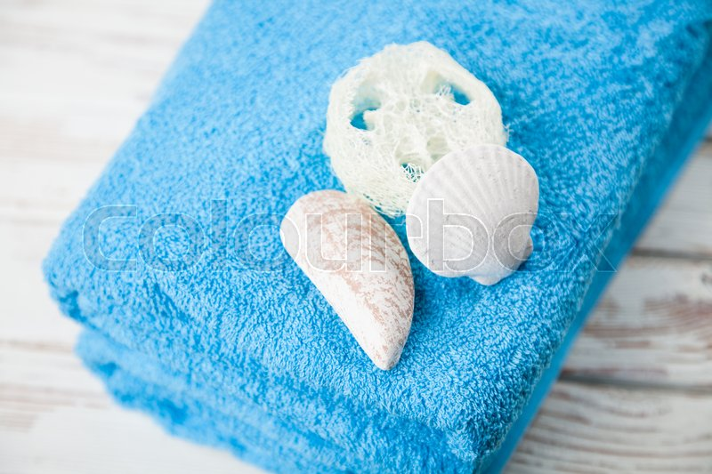 Stock image of 'Pair of folded oft blue towels'