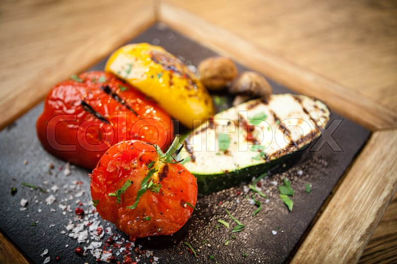 Stock image of 'Grilled vegetables. Tomato, zucchini paprika and potatoes'
