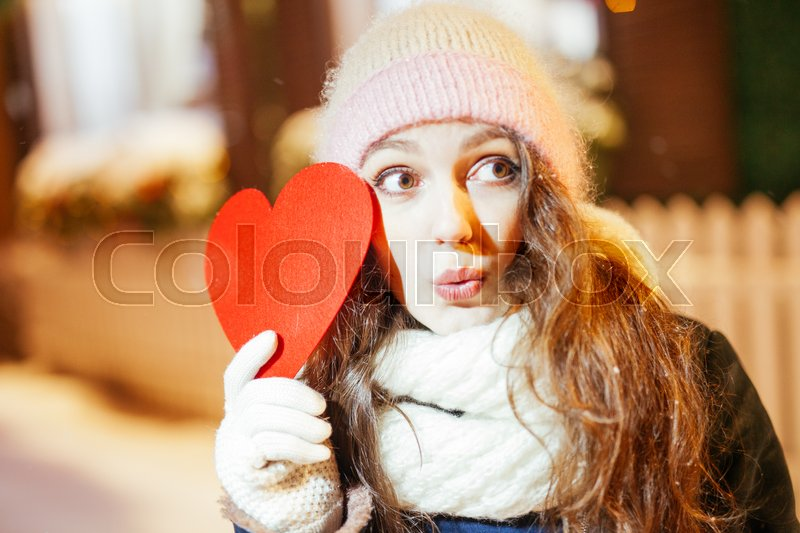 Stock image of 'Girl holding heart on Valentine's day in winter outdoors.'