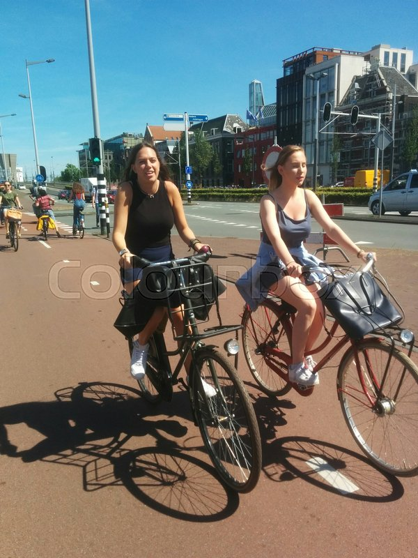 Stock image of 'cyclists, amsterdam, netherlands'