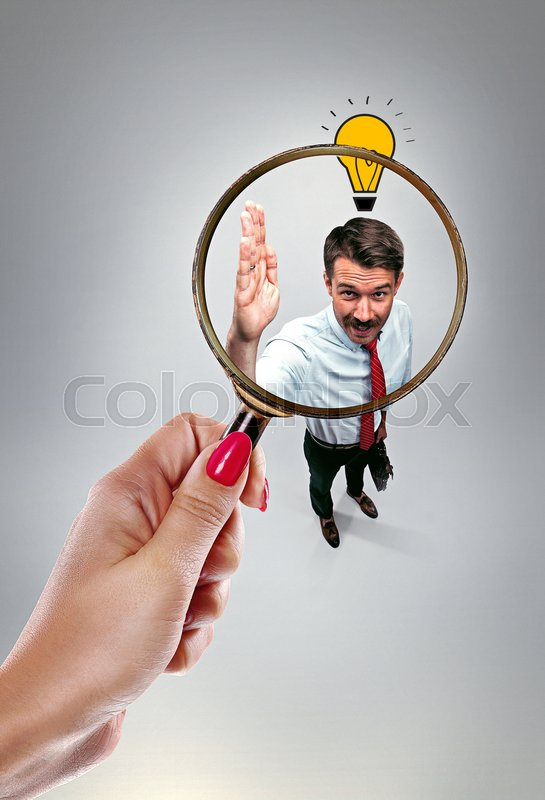 Stock image of 'Job interview with manager in office. Concept of choose the best candidate. Female hand with magnifier'