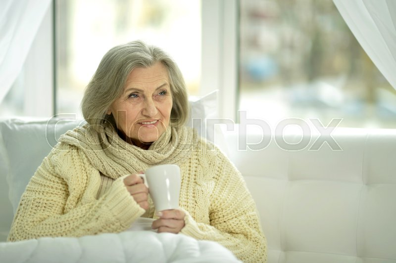 Stock image of 'Close up portrait of senior woman drinking tea'