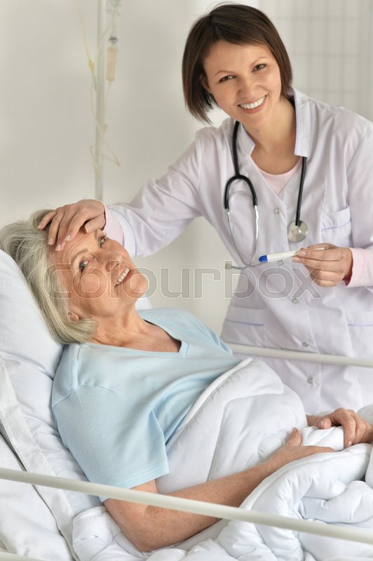 Stock image of 'female doctor taking care of senior patient'