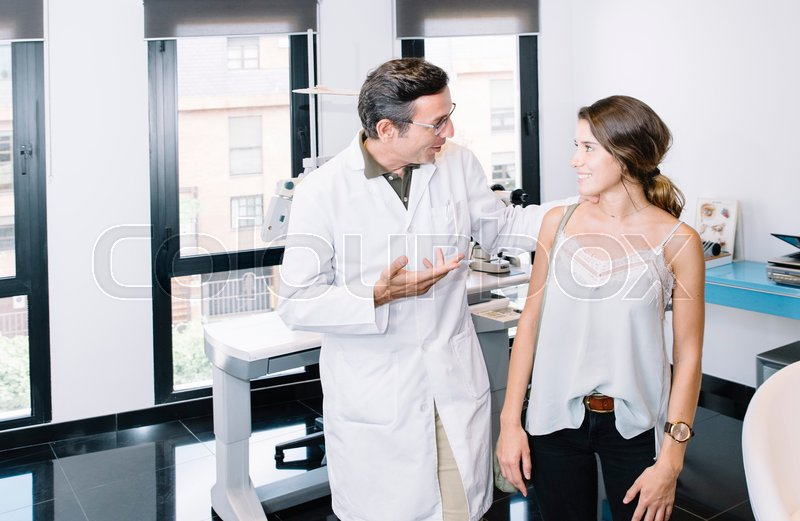 Stock image of 'Male doctor with female patient '