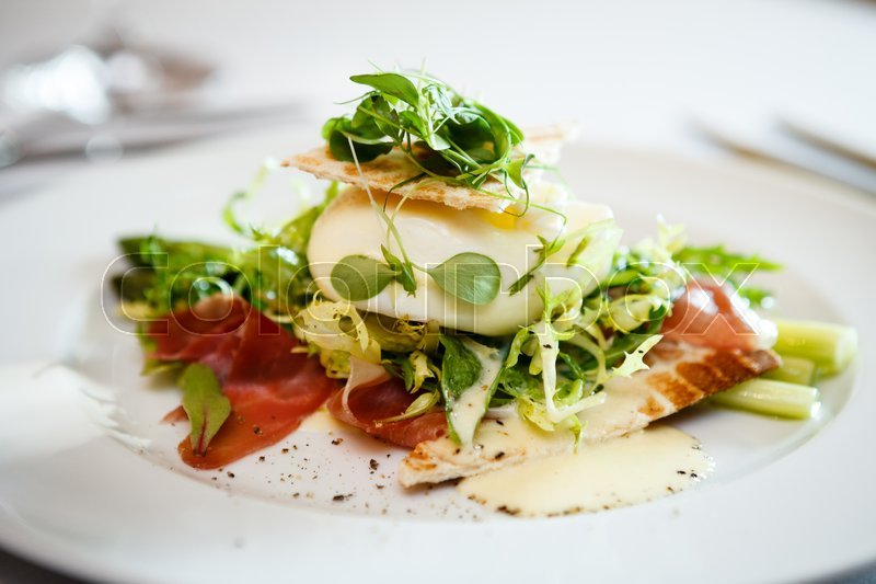 Stock image of 'Fresh salad of mozzarella, ham and garden asparagus served on white plate'