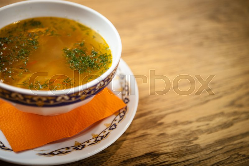 Stock image of 'Chicken soup with handmade noodles on chicken broth with seasonings and vegetables.'