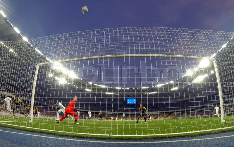Editorial image of 'KYIV, UKRAINE - JULY 26, 2017: FC Dynamo Kyiv players (in White) attack the Young Boys net during their UEFA Champions League 3rd qualifying round game at NSC Olimpiyskyi stadium in Kyiv, Ukraine'