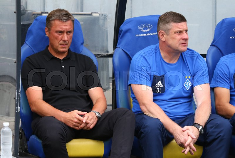 Editorial image of 'KYIV, UKRAINE - JULY 26, 2017: FC Dynamo Kyiv manager Aleksandr Khatskevich (L) looks on during UEFA Champions League 3rd qualifying round game against Young Boys at NSC Olimpiyskyi stadium in Kyiv'