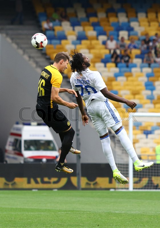 Editorial image of 'KYIV, UKRAINE - JULY 26, 2017: Dieumerci Mbokani of Dynamo Kyiv (R) fights for a ball with Christian Fassnacht of Young Boys during their UEFA Champions League 3rd qualifying round game'