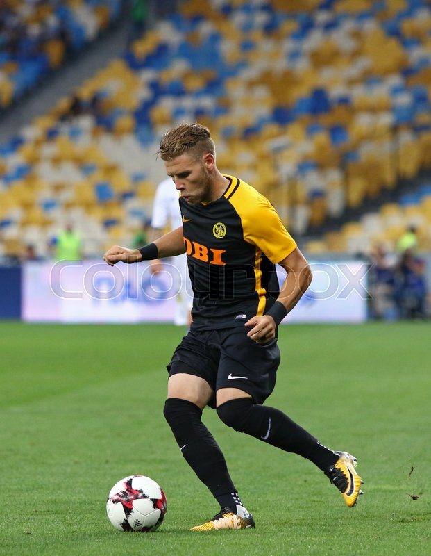 Editorial image of 'KYIV, UKRAINE - JULY 26, 2017: Yoric Ravet of Young Boys controls a ball during UEFA Champions League 3rd qualifying round game against FC Dynamo Kyiv at NSC Olimpiyskyi stadium in Kyiv, Ukraine'