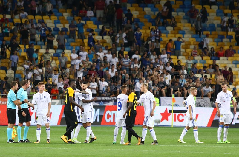 Editorial image of 'KYIV, UKRAINE - JULY 26, 2017: FC Dynamo Kyiv (in White) and Young Boys players cheer each other after their UEFA Champions League 3rd qualifying round game at NSC Olimpiyskyi stadium in Kyiv, Ukraine'