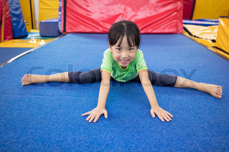 Stock image of 'Asian Chinese little girl playing at indoor playground'