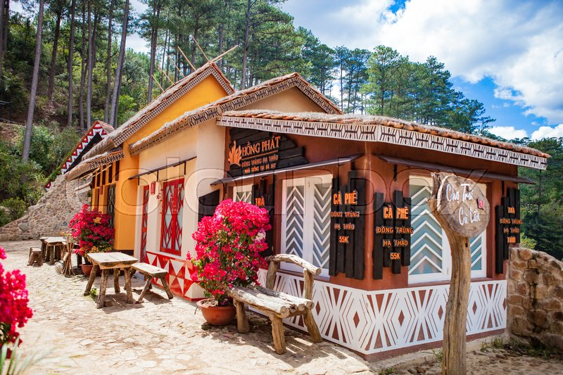 Stock image of 'DALAT, VIETNAM - February 17, 2017: Cu Lan village at Dalat countryside, hotel and holiday resort among pine jungle, camp on grass field, an eco tourism in nature reserse'