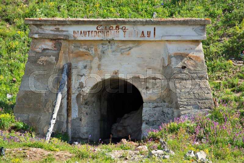 Stock image of 'Buildings of the old abandoned mercury mine Aktash. Altai Mountains, Siberia, Russia.'