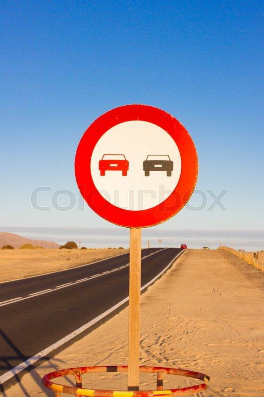 Stock image of 'No overtaking. Prohibited to advance indicating. Circular round red traffic sign. Indication limit'