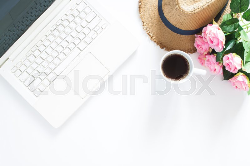 Stock image of 'Flat lay of computer laptop with casual hat, a cup of coffee and pink roses, Top view on white background with copy space'