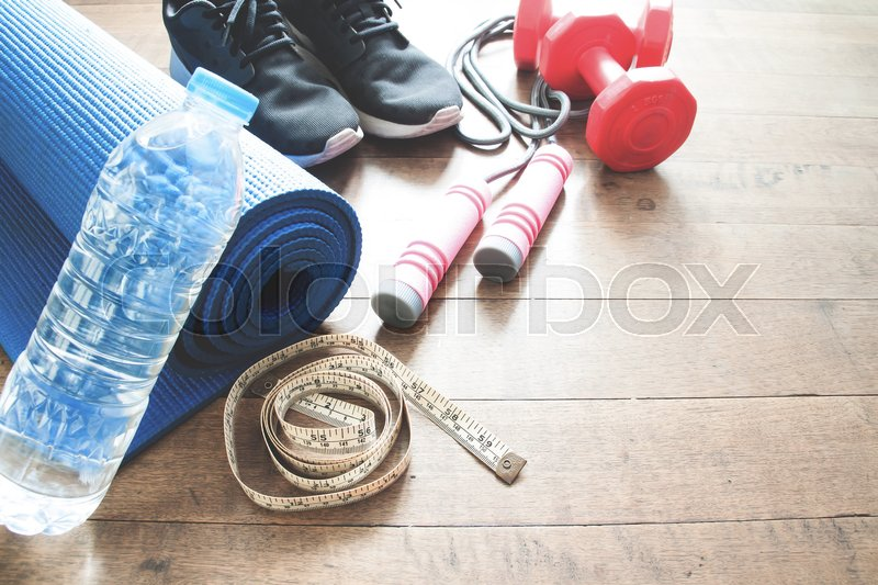 Stock image of 'Sport equipments on wood floor, Working out concept'