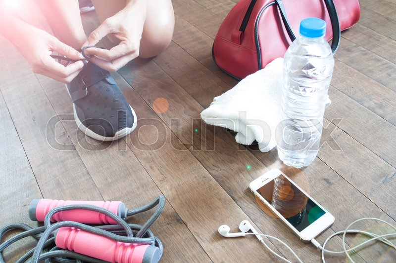 Stock image of 'Sport fitness concept with female and sport equipments, mobile device and water, Healthy lifestyle'
