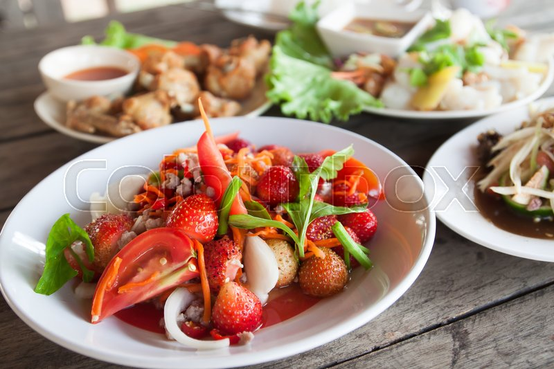 Stock image of 'Strawberry spicy salad on white plate, Spacial menu in Thailand'