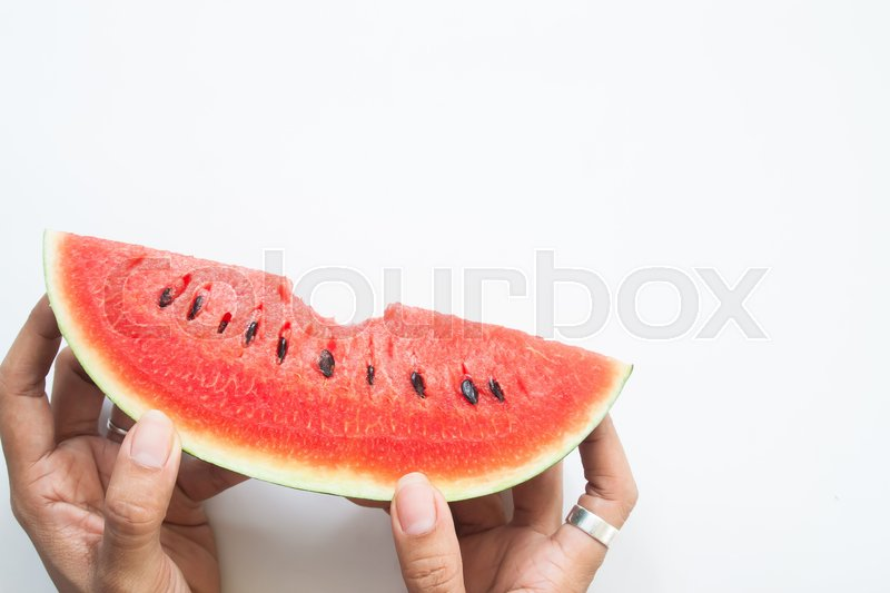 Stock image of 'Woman hand holding piece of fresh watermelon, Summer healthy concept'