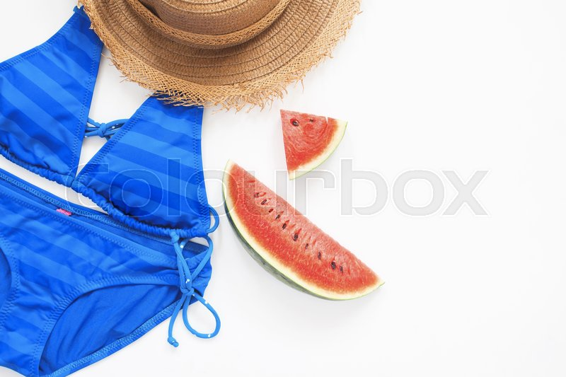 Stock image of 'Flat lay of swimwear in blue color with watermelon, Summer concept'