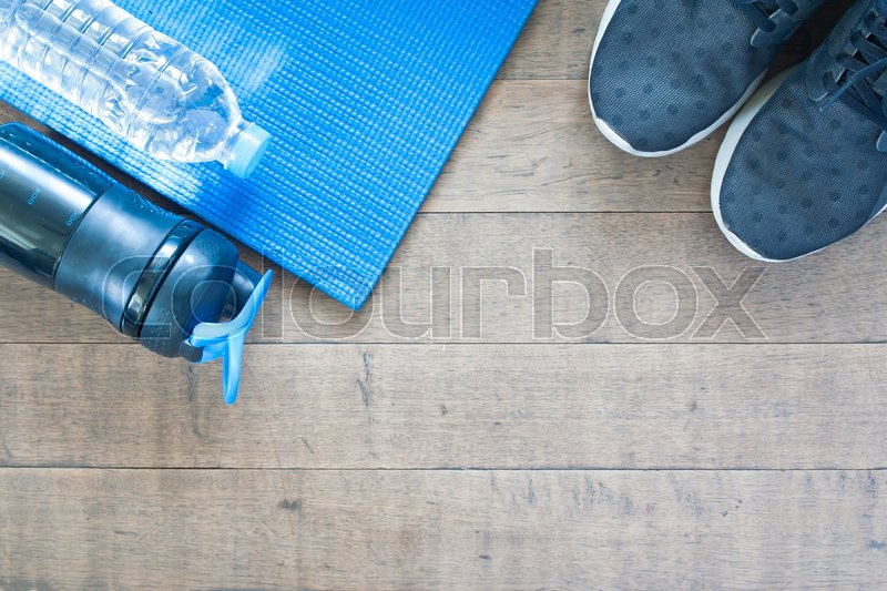 Stock image of 'Sport and workout equipment on wood background, Flat lay of healthy lifestyle concept'