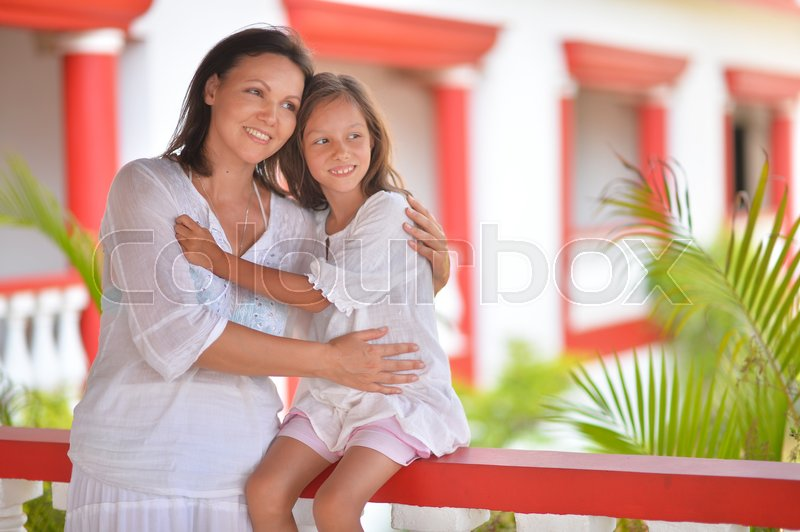 Stock image of 'Family portrait of happy mother and daughter hugging together'