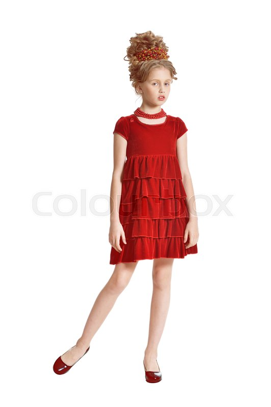 Stock image of 'Cute little girl in red velvet dress with retro hairstyle isolated on white background'