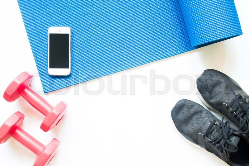 Stock image of 'Flat lay of sport equipments with smartphone on white background'