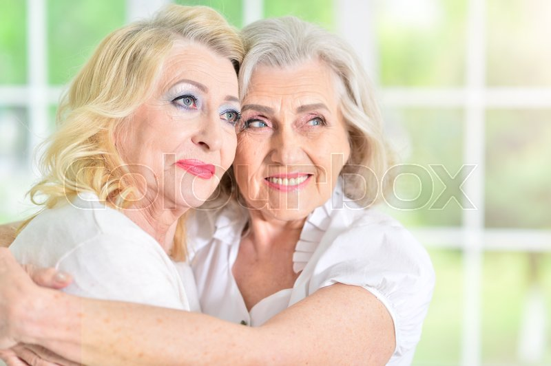 Stock image of 'Close up portrait of mature woman hugging her mother'