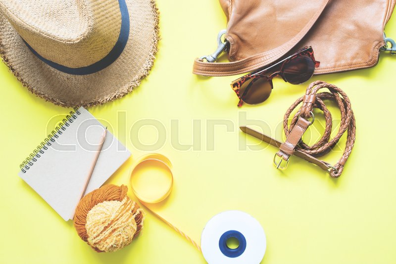 Stock image of 'Overhead view of girl accessories in yellow and brown color, Spring fashion set'
