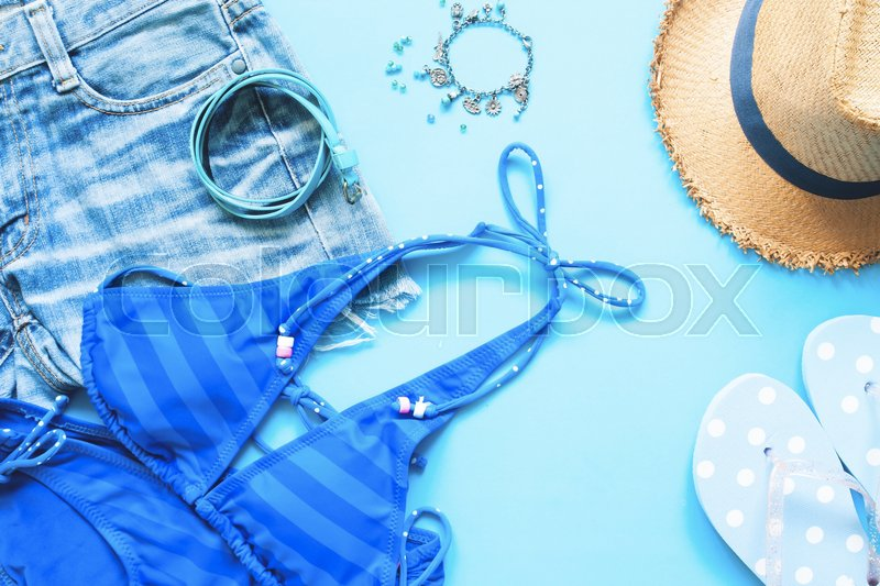 Stock image of 'Spring and summer blue collection of girl accessories, Flat lay on blue  background'