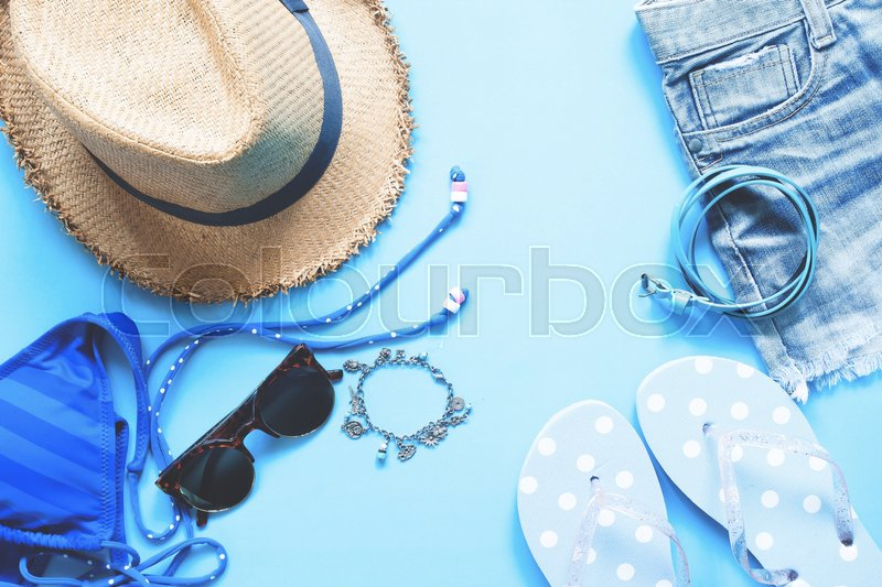 Stock image of 'Flat lay of female asccessories on blue background, Spring and summer fashion concept'
