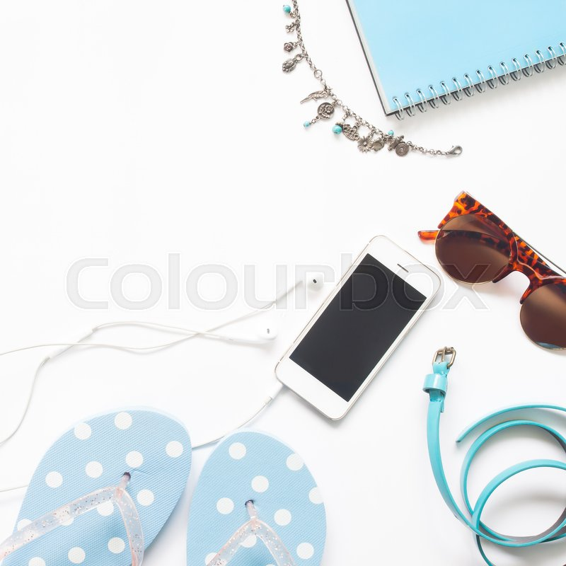 Stock image of 'Flat lay of woman accessories in blue color collection with smartphone isolated on white background'