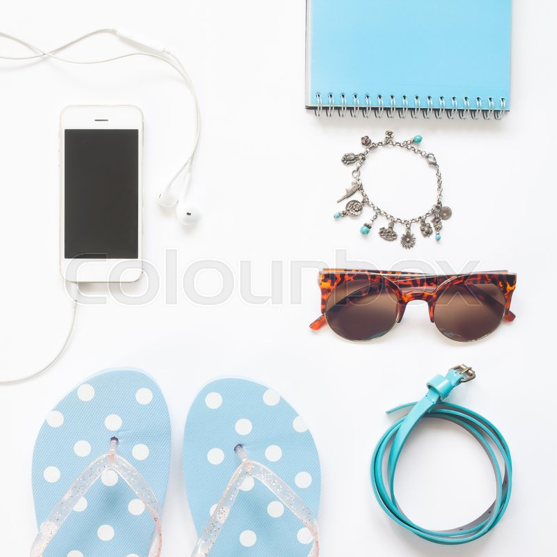 Stock image of 'Overhead view of woman accessories in pastel blue and white color collection, Spring summer fashion set'