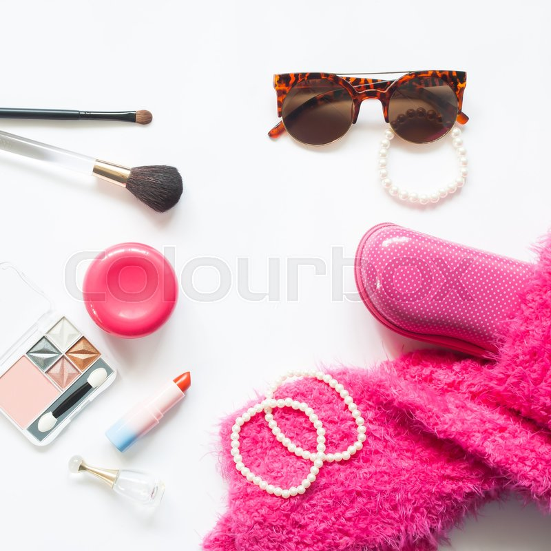 Stock image of 'Set of decorative cosmetics and woman essentials in pink color collection on white background'